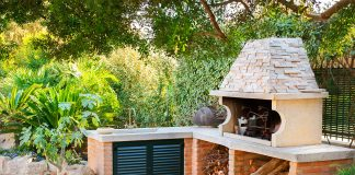 Outdoor kitchen with oven and sink