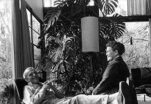 Charles and Ray laughing together in the #Eames House living room.