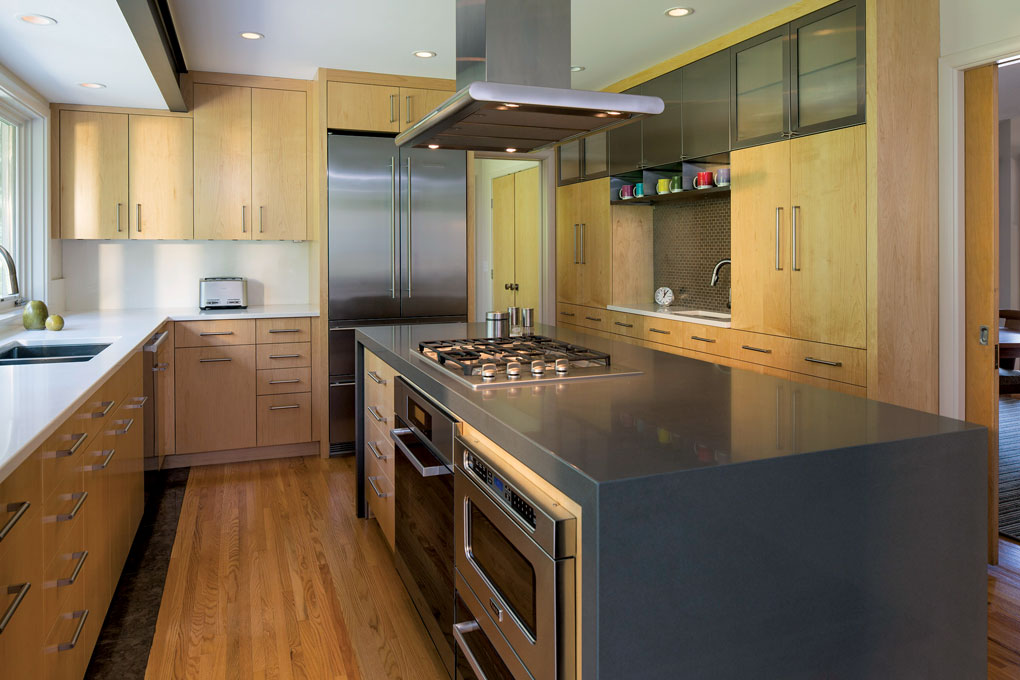 Light wood floors and cabinetry are accented by stainless steel appliances and a large center island.