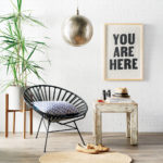 Laid-back home decor that includes a leather chair, berlin planter and Laguna table.