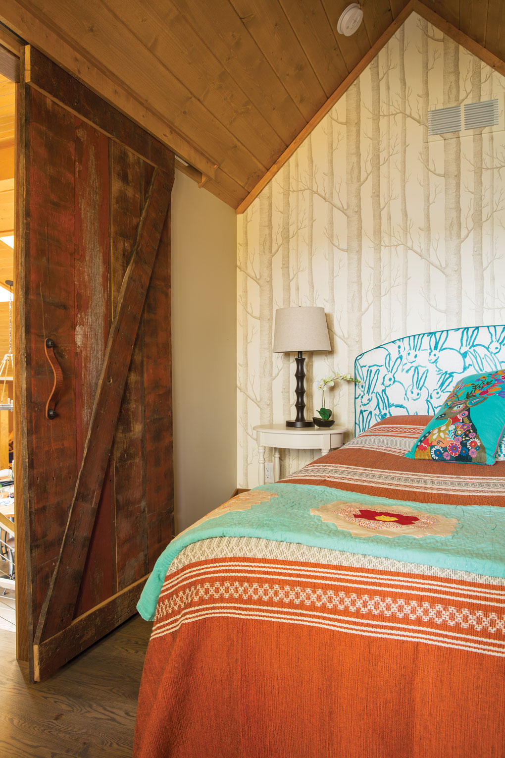 A loft bedroom featuring vintage items in a cabin in Luck, Wisconsin.