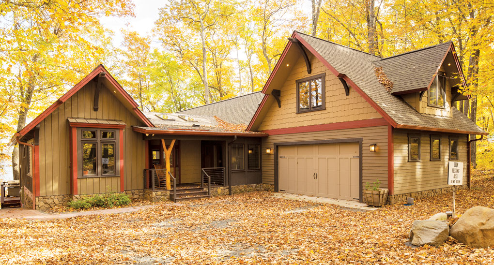 """The """"after"""" photo of a cabin exterior in Luck, Wisconsin."""