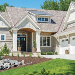 The exterior of a cottage-style home built by M & M Home Contractors.