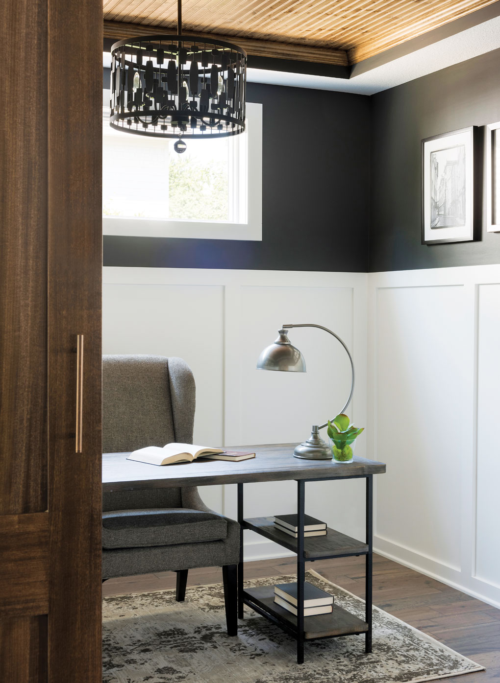 A home office with desk, chair and lamp.
