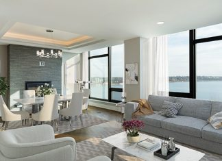 living room with floor to ceiling windows facing the lake