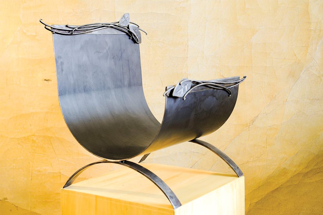An iron chair by Elias Metal Studio.
