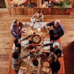 Friends gathered around a table toasting
