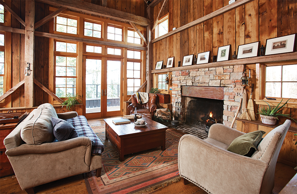 Chairs inside wooden cabin with fireplace