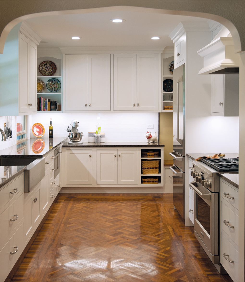 White kitchen with white cabinets and light brown floor