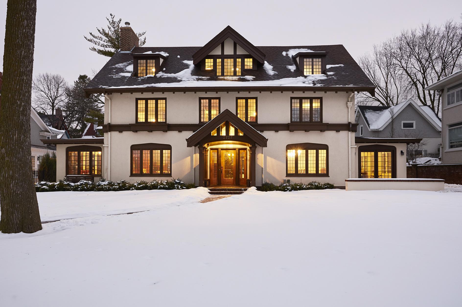 Big white house with dark wood paneling