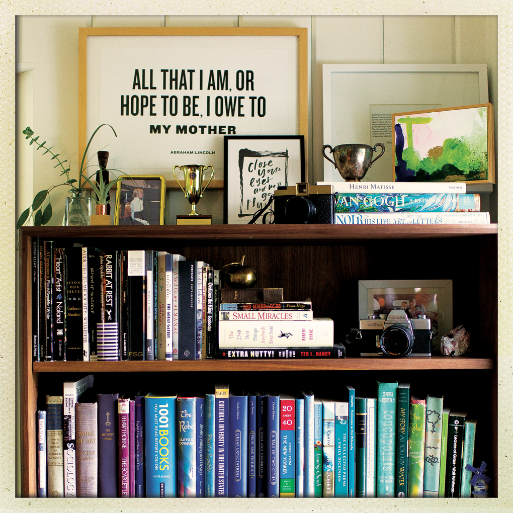 Framed lyrics on top of a bookshelf.