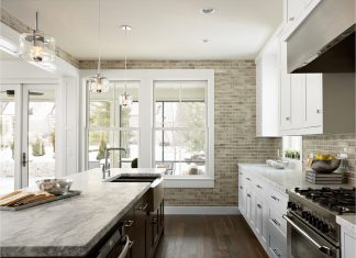 All white kitchen with dark hardwood floors