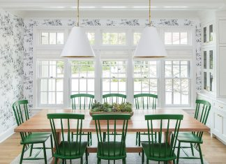 white dining room with green chairs