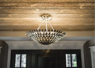 A chandelier hanging from the ceiling by Muska Lighting.