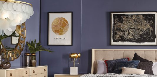 Blue bedroom with gray bed