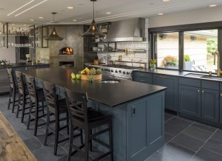 Photo of a renovated kitchen by Erotas Custom Building and Shelter Architecture
