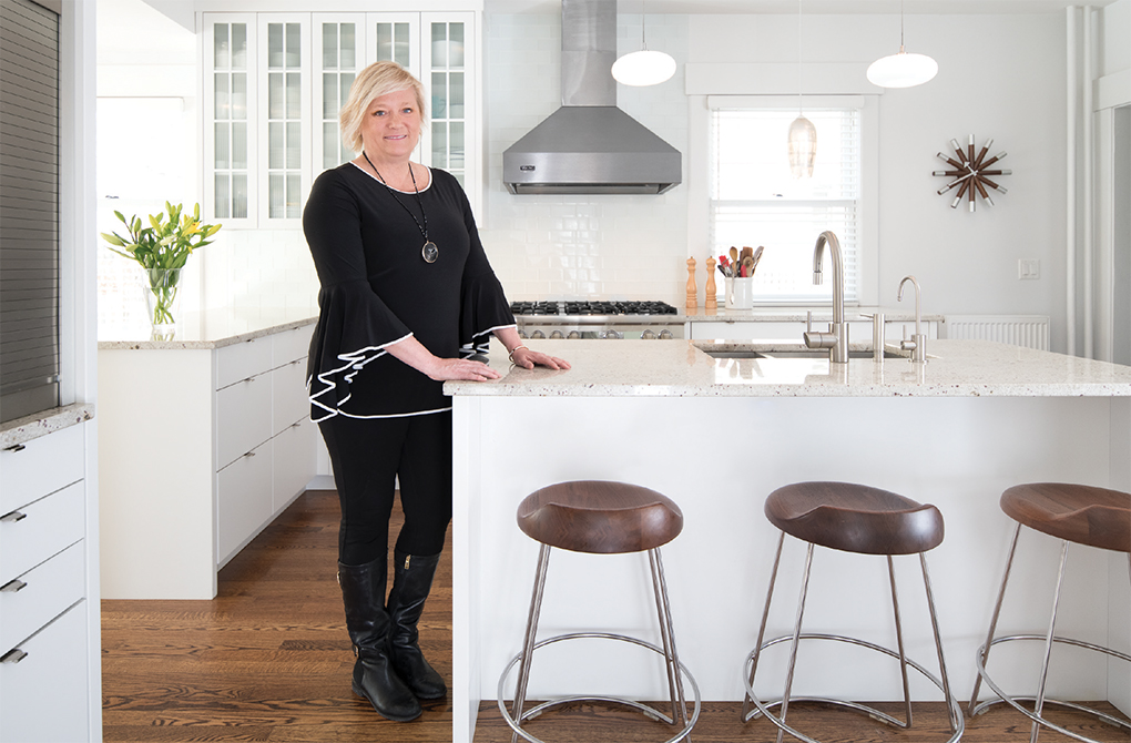 Architect Jackie Millea in a St. Paul kitchen she remodeled, redesigning a long, narrow space into a light-filled, functional cook's kitchen.