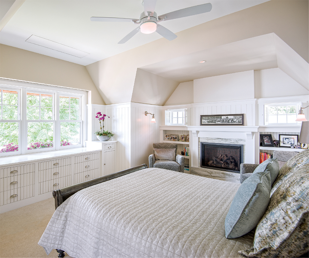 The master bedroom includes a wall of built-in storage.