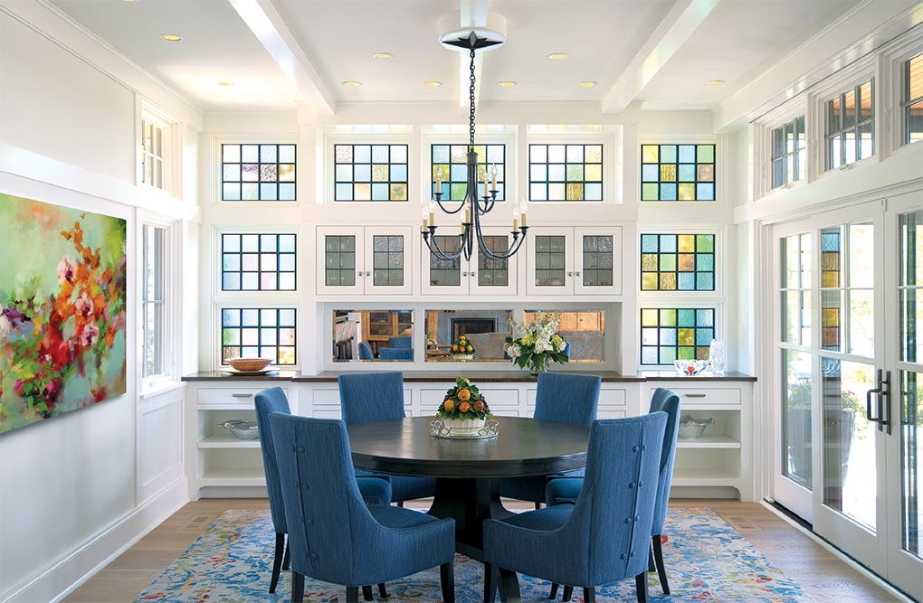 The stained-glass squares surrounding the built-in buffet remind Norm of his grandparents' 1890s home.