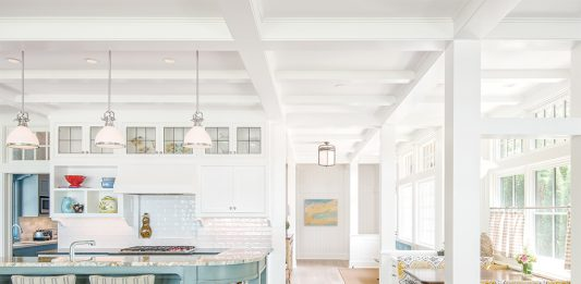 The classic kitchen, with its painted island and cozy booth, evokes the cottage character the couple envisioned.