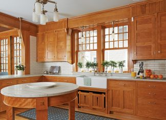This 1908 home, designed by Franklin Ellerbe, had become a mish-mash of styles until its new owners and David Heide Design Studio melded its past with modern functionality. The red birch cabinetry—the same wood used in Ellerbe's original—returns this kitchen to its Arts and Crafts roots.