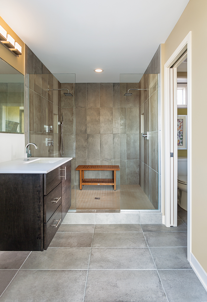 The upstairs was reconfigured by Close Associates to create a master suite with a roomy shower.