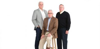 Photo of three men posing for a portrait