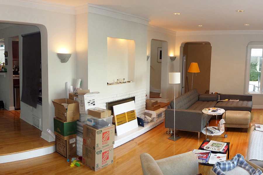 A cluttered living room before it was remodeled by Renovation Design and Build.