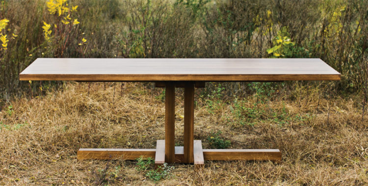 A long wooden table made by Grant Kaihoi.