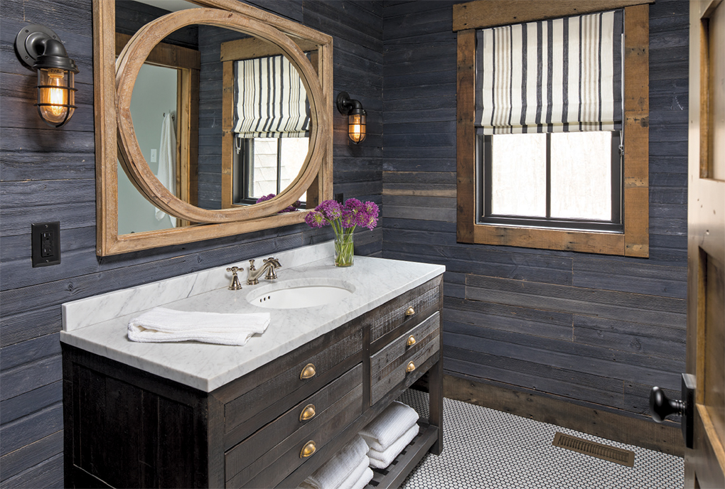 One bathroom features blue-stained wood panels, adding variety to the home's finishes.
