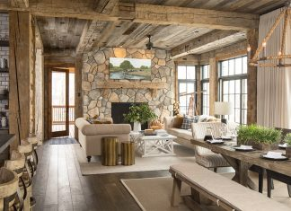 The open living spaces are tied together with reclaimed wood beams, posts, and ceilings.