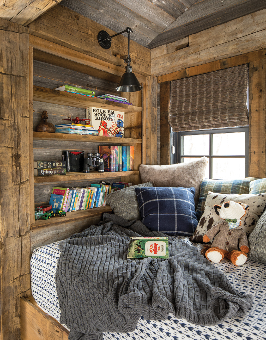 This nook is a snug hideaway for reading or napping.