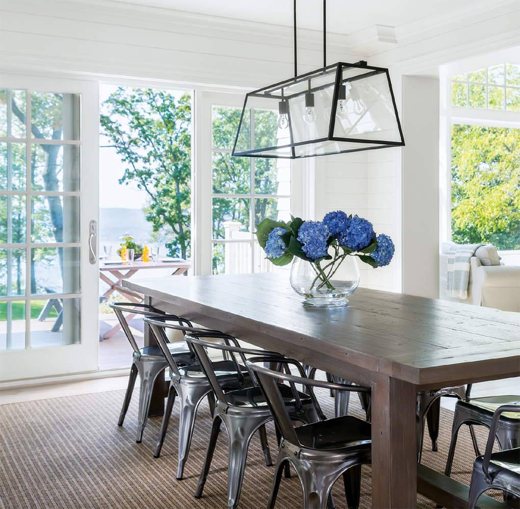 A large dining room that opens up to a patio on located on Lake Pepin.