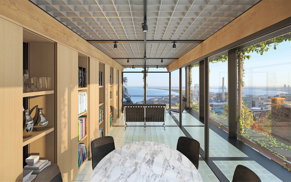 Inside a home with windows for walls overlooking Lake Superior.