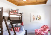 The red bedroom: Each bedroom features an ensuite bath, a white-oak tray ceiling, and a twin and a queen bed.