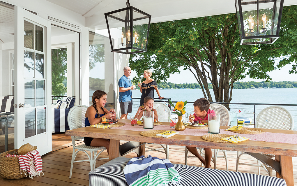 Erin and Charlie Zosel enjoy the deck, while the kids (left to right) Melissa Remick, 12, Sloane Zosel, 8, and Adam Remick, 10, grab a light lunch before heading back to the water.