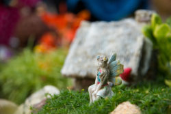 Closeup of fairy garden. Miniature houses placed to resemble a village scene in a magical land.