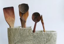 Utensil holder with spoons. Geometric, lots of lines