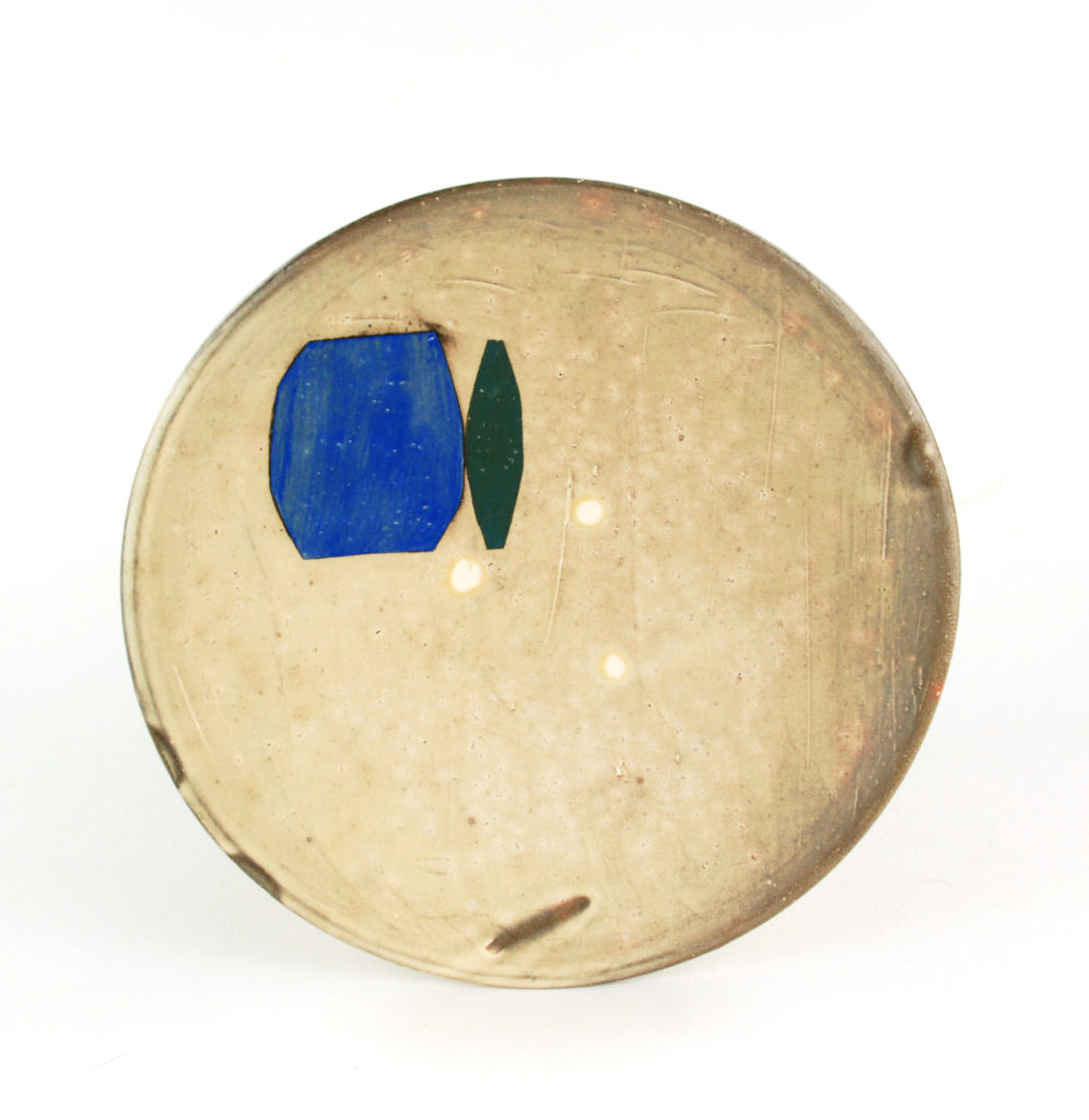 ceramic dinner plate with small blue and green detail