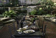 Dry-stack stone wall and old wood dining table in Minneapolis garden