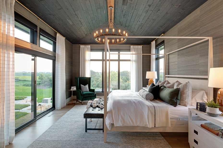 Photo of a bedroom with floor-to-ceiling windows